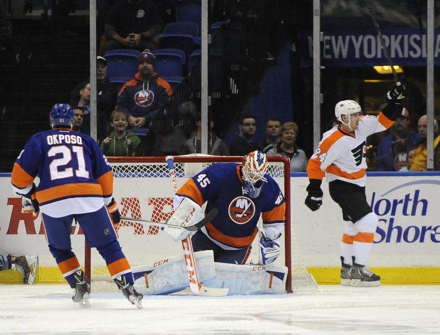 Philadelphia Flyers' Matt Read (24) celebrates his goal against New York Islanders goalie Anders Nilsson (45) in the second period of an NHL hockey game on Monday, Jan. 20, 2014, in Uniondale, N.Y. (AP Photo/Kathy Kmonicek)