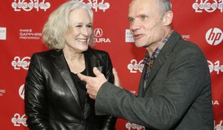 "Cast members Glenn Close, left, and Flea of the Red Hot Chili Peppers greet each other at the premiere of the film ""Low Down"" during the 2014 Sundance Film Festival, on Sunday, Jan. 19, 2014 in Park City, Utah. (Photo by Danny Moloshok/Invision/AP)"