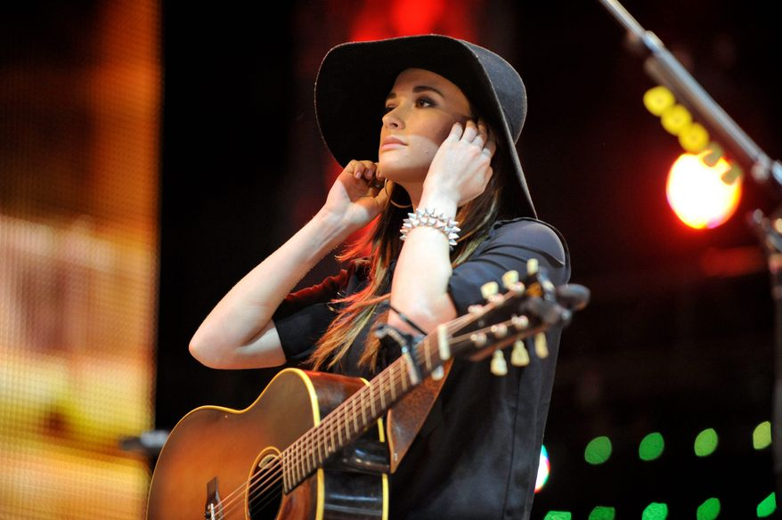 The sassy, subversive Kacey Musgraves has taken the country music world by storm. Among her four Grammy nominations is one for best new artist. (Associated Press photographs)