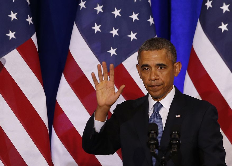** FILE ** In this Jan. 17, 2014, file photo, President Barack Obama waves to the audience after he spoke about National Security Agency (NSA) surveillance, at the Justice Department in Washington. (AP Photo/Charles Dharapak, File)