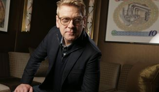 """FILE - In this Friday, Jan. 10, 2014 file photo, director and actor Kenneth Branagh poses for a portrait to promote """"Jack Ryan: Shadow Recruit,"""" in Beverly Hills, Calif. The film releases in the U.S. on Friday, Jan. 17, 2014. (Photo by Eric Charbonneau/Invision/AP, file)"""