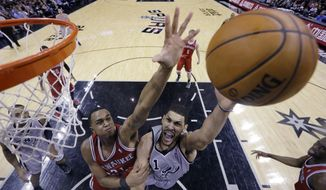 San Antonio Spurs' Jeff Ayres, right, is defended by Milwaukee Bucks' John Henson (31) as he drives to the basket during the second half of an NBA basketball game, Sunday, Jan. 19, 2014, in San Antonio. San Antonio won 110-82. (AP Photo/Eric Gay)