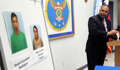 McAllen Police Chief Victor Rodriguez displays photos of Daniel Guardiola Dominiguez, left, and Mary Carmen Garcia, who were arrested Sunday after arriving at the border with 96 fraudulent credit cards that were produced using data stolen during the Target security breach late last year, Monday, Jan. 20, 2014, in McAllen, Texas. (AP Photo/The Monitor, Gabe Hernandez)  MAGS OUT; TV OUT