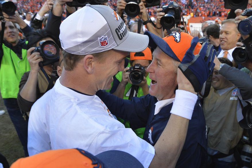Denver Broncos quarterback Peyton Manning, left, celebrates with Denver Broncos head coach John Fox after the AFC Championship NFL playoff football game against the New England Patriots in Denver, Sunday, Jan. 19, 2014. The Broncos defeated the Patriots 26-16 to advance to the Super Bowl. (AP Photo/Jack Dempsey)