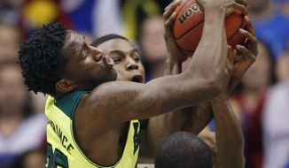 Baylor forward Taurean Prince, left, goes for a rebound against Kansas guard Andrew Wiggins during the first half of an NCAA college basketball game in Lawrence, Kan., Monday, Jan. 20, 2014. (AP Photo/Orlin Wagner)