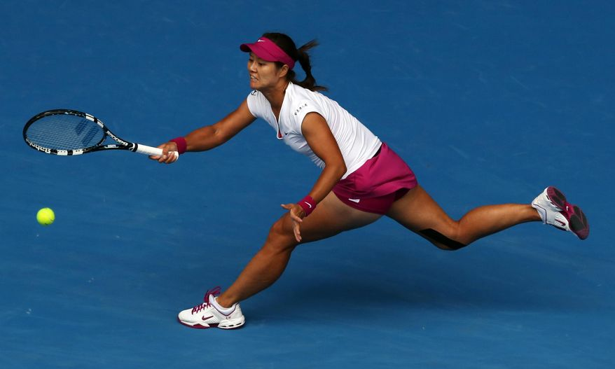Li Na of China reaches for a shot to Flavia Pennetta of Italy during their quarterfinal at the Australian Open tennis championship in Melbourne, Australia, Tuesday, Jan. 21, 2014.(AP Photo/Eugene Hoshiko)