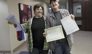 FILE - This Dec. 20, 2013 file photo shows Elise Larsen, left, and Samantha Christensen, right, displaying their marriage license after being one of the first same sex couples to receive one at the Salt Lake County Clerk's Office in Salt Lake City. Hours after federal judges struck down bans on same-sex marriage in Utah and Oklahoma, activist Evan Wolfson and his colleagues reached out to gay rights groups in the deeply conservative states with both congratulations and a reminder: Court wins alone won't be enough.  (AP Photo/Kim Raff, file)