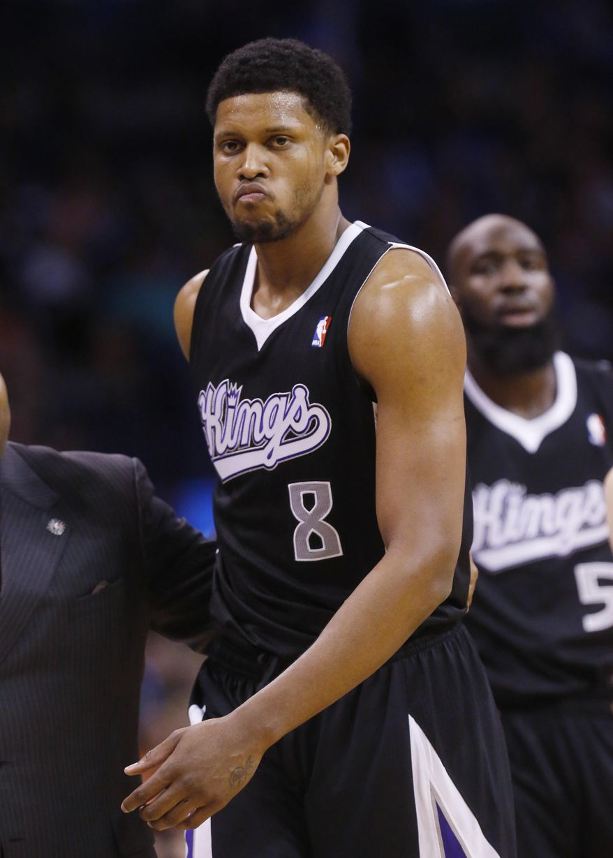 Sacramento Kings forward Rudy Gay (8) leaves the court after being ejected from the game in the fourth quarter of an NBA basketball game against the Oklahoma City Thunder in Oklahoma City, Sunday, Jan. 19, 2014. Oklahoma City won 108-93. (AP Photo/Sue Ogrocki)