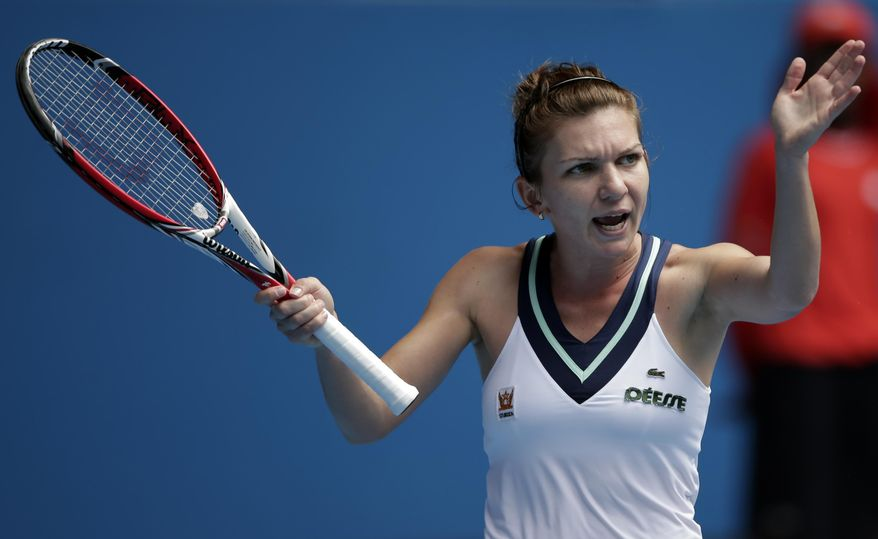 Simona Halep of Romania disputes a point during her fourth round match against Jelena Jankovic of Serbia at the Australian Open tennis championship in Melbourne, Australia, Monday, Jan. 20, 2014.(AP Photo/Rick Rycroft)