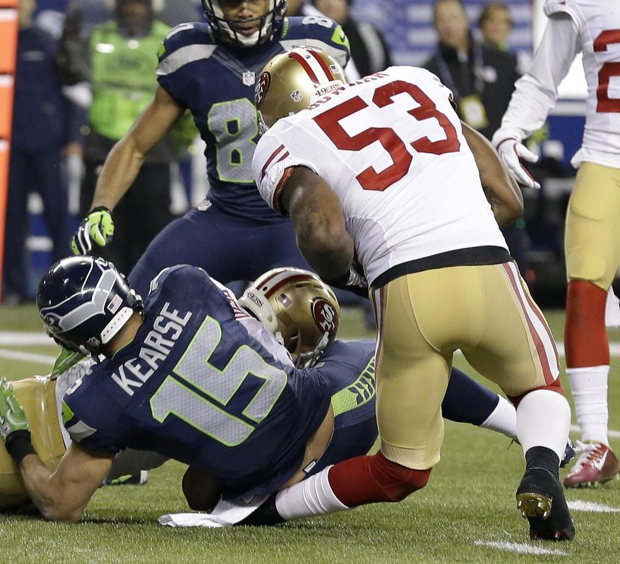 San Francisco 49ers' NaVorro Bowman injures his leg during the second half of the NFL football NFC Championship game against the Seattle Seahawks, Sunday, Jan. 19, 2014, in Seattle. (AP Photo/Elaine Thompson)