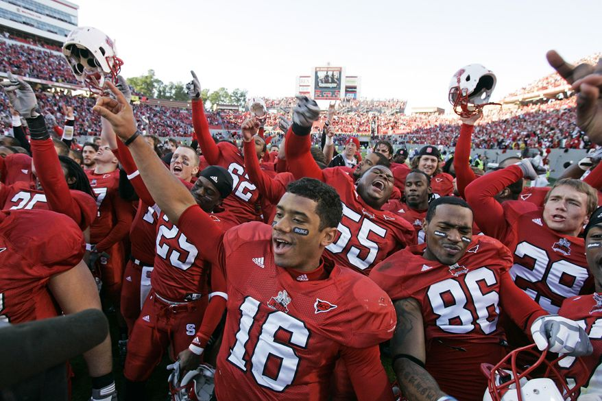 North Carolina State quarterback Russell Wilson (16) celebrates with his team following an NCAA college football game against North Carolina in Raleigh, N.C., Saturday, Nov. 28, 2009. North Carolina State won 28-27. (AP Photo/Gerry Broome)