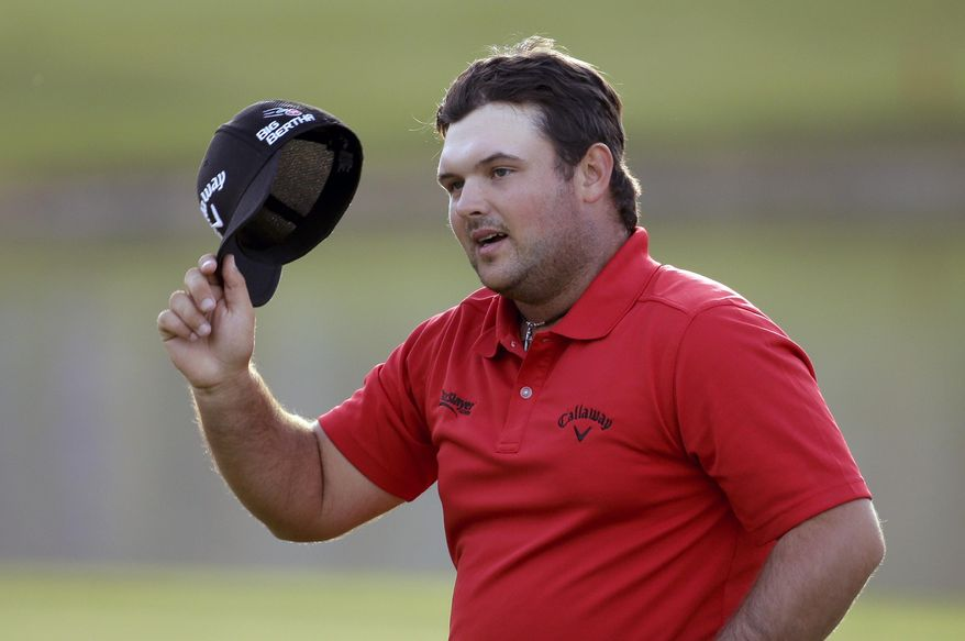 Patrick Reed waves after winning the Humana Challenge golf tournament on the Palmer Private course at PGA West, Sunday, Jan. 19, 2014 in La Quinta, Calif. (AP Photo/Chris Carlson)