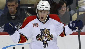 Florida Panthers' Drew Shore (15) celebrates his goal in the first period of an NHL hockey game against the Pittsburgh Penguins in Pittsburgh, Monday, Jan. 20, 2014. (AP Photo/Gene J. Puskar)