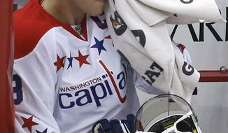 Washington Capitals' Alex Ovechkin (8) sits on the bench during an NHL hockey game between the Pittsburgh Penguins and the Washington Capitals in Pittsburgh, Wednesday, Jan. 15, 2014. The Penguins won 4-3.(AP Photo/Gene J. Puskar)