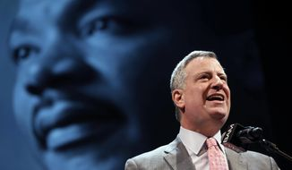 "New York City Mayor Bill de Blasio speaks at a tribute to Martin Luther King, Jr. in the Brooklyn borough of New York, Monday, Jan. 20, 2014. De Blasio told a packed audience Monday at the Brooklyn Academy of Music that the ""price of inequality has deepened."" The mayor says economic inequality is closing doors for hard-working people in the city and around the country. (AP Photo/Seth Wenig)"
