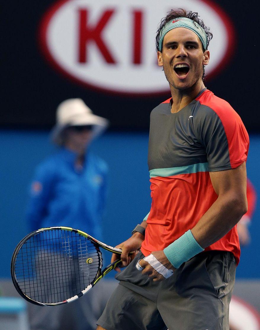 Rafael Nadal of Spain celebrates after defeating Kei Nishikori of Japan during their fourth round match at the Australian Open tennis championship in Melbourne, Australia, Monday, Jan. 20, 2014.(AP Photo/Aaron Favila)