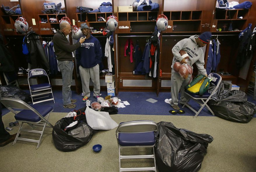 New England Patriots free safety Devin McCourty talks to a reporter, left, while standing in front of his locker as cornerback Alfonzo Dennard, right, packs up his personal items in the locker room at the NFL football team's facility in Foxborough, Mass., Monday, Jan. 20, 2014. The Patriots lost to the Denver Broncos in the AFC Championship game Sunday in Denver ending their season. (AP Photo/Stephan Savoia)