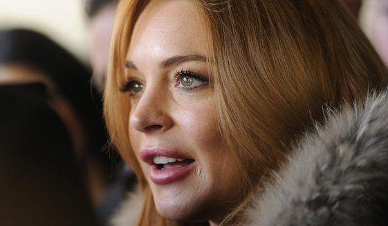 Actress Lindsay Lohan is interviewed following a news conference at the 2014 Sundance Film Festival, Monday, Jan. 20, 2014, in Park City, Utah. (Photo by Chris Pizzello/Invision/AP) ** FILE **
