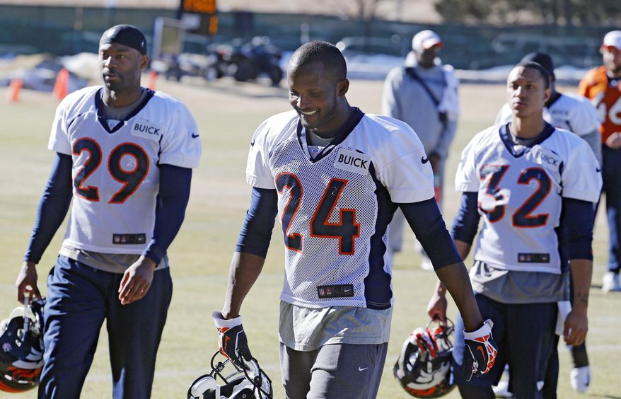 FILE - In this Jan. 17, 2014 file photo, Denver Broncos cornerback Champ Bailey (24) walks off the field free safety Michael Huff (29) and cornerback Tony Carter (32) after NFL football practice at the team's training facility in Englewood, Colo. The Broncos are scheduled to play the Seattle Seahawks in the NFL Super Bowl on Feb. 2, in East Ruterford, N.J. It will be Bailey's first Super Bowl. (AP Photo/Ed Andrieski, File)