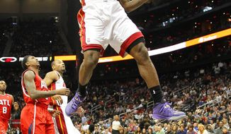 Miami Heat small forward LeBron James (6) dunks in the first period of an NBA basketball game against the Miami Heat in Atlanta, Monday, Jan. 20, 2014. (AP Photo/Todd Kirkland)
