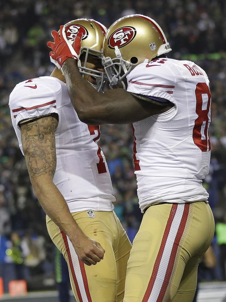 San Francisco 49ers' Anquan Boldin celebrates his touchdown catch with quarterback Colin Kaepernick (7) during the second half of the NFL football NFC Championship game against the Seattle Seahawks Sunday, Jan. 19, 2014, in Seattle. (AP Photo/Marcio Jose Sanchez)