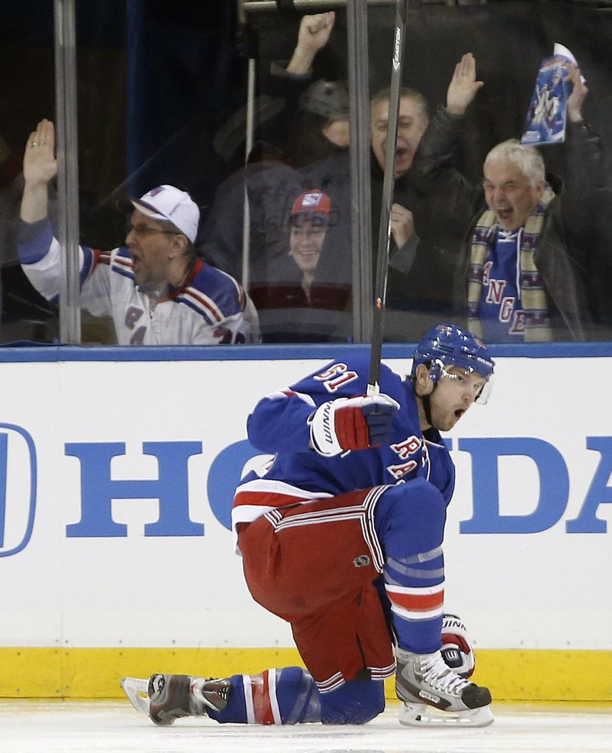New York Rangers left wing Rick Nash (61) reacts after scoring a goal in the first period of an NHL hockey game against the Washington Capitals at Madison Square Garden in New York, Sunday, Jan. 19, 2014. Nash scored two goals in the period. (AP Photo/Kathy Willens)