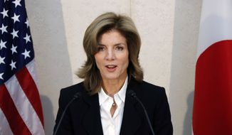 In this Friday, Nov. 15, 2013, file photo, U.S. Ambassador to Japan Caroline Kennedy gives a statement shortly after her arrival in Japan at the Narita International Airport in Narita, east of Tokyo. (AP Photo/Koji Sasahara, Pool, File) ** FILE **