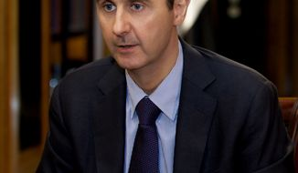 FILE - In this Monday, Oct. 21, 2013 file photo, which AP obtained from Syrian official news agency SANA and which has been authenticated based on its contents and other AP reporting, President Bashar Assad gestures as he speaks during an interview with Lebanon's Al-Mayadeen TV, at the presidential palace in Damascus, Syria. With stakes high and expectations low, Syria's government and its opponents sit down face-to-face at an international peace conference this week for the first time _ muscled to the negotiating table by foreign powers that fear the bloodiest of the Arab Spring uprisings may engulf the entire region in sectarian war. (AP Photo/SANA, File)