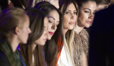 Kim Kardashian, second from the right, attends Stephane Rolland's Spring-Summer 2014 Haute Couture fashion collection presented in Paris, Tuesday, Jan.21, 2014. (AP Photo/Jacques Brinon)