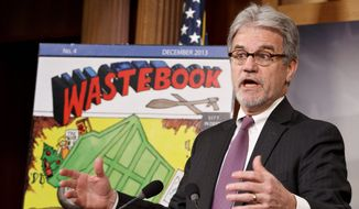 FILE - In this Dec. 17, 2013 file photo, Sen. Tom Coburn, R-Okla., a longtime deficit hawk, outlines his annual Wastebook, which points a critical finger at billions of dollars in questionable government spending during a news conference on Capitol Hill in Washington. U.S. Sen. Tom Coburn says he plans to finish the current year in office and resign his seat nearly two years before his term is scheduled to end. The 66-year-old Coburn released a statement late Thursday, Jan. 16, 2014  saying he would give up his seat at the end of the current session of Congress, scheduled to end in January 2015.(AP Photo/J. Scott Applewhite, File)
