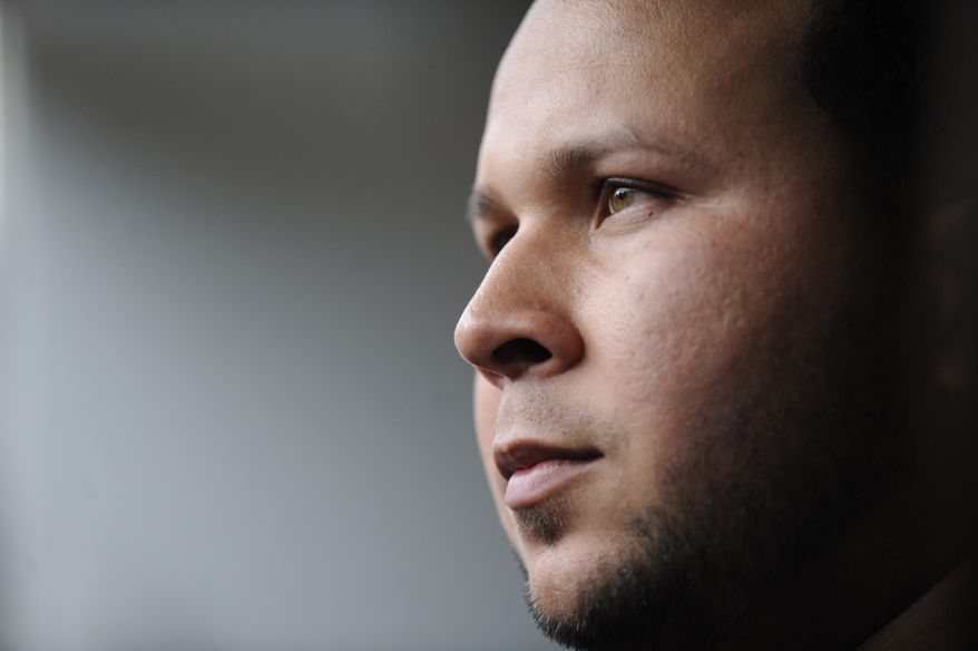 File-This Sept. 11, 2013, file photo shows suspended Detroit Tigers shortstop Jhonny Peralta looking on after working out with the team before an MLB baseball game against the Chicago White Sox in Chicago. Matt Holliday has been an outspoken critic of players who have used performance-enhancing drugs. When it comes to Peralta, his new St. Louis Cardinals teammate, he is willing to forgive and forget. (AP Photo/Paul Beaty, File)