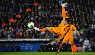 Real Madrid's Cristiano Ronaldo, from Portugal, kicks the ball against Espanyol during a Copa del Rey soccer match at Cornella-El Prat stadium in Cornella Llobregat , Spain, Tuesday, Jan.21, 2014. (AP Photo/Manu Fernandez)