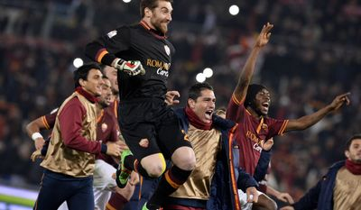 AS Roma's Morgan De Sanctis, Marco Borriello and Gervinho, right, celebrate their 1-0 win over Juventus, at the end of an Italian Cup, round of eight, soccer match, at Rome's Olympic stadium, Tuesday, Jan. 21, 2014. (AP Photo/Alfredo Falcone, Lapresse)