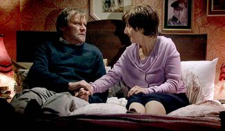 "In this photo provided by ITV plc, on Tuesday, Jan. 21, 2014, television characters Roy and Hayley Cropper, played by David Neilson and Julie Hesmondhalgh, in a scene from Coronation Street.  It was one of the gentlest deaths in soap-opera history, but it has provoked a strong reaction in Britain. More than 10 million people watched the long-running soap ""Coronation Street"" on Monday, evening, as Hayley Cropper, sick with incurable pancreatic cancer, took an overdose of drugs and died in the arms of her loving husband Roy. Some praised the storyline for its sensitive handling of illness and death, but others said it risked encouraging suicides. Right-to-die campaigner Jane Nicklinson, whose late husband battled for the right to have a doctor help him end his life, said the story had ""done our cause proud."" But anti-euthanasia group Care Not Killing said Tuesday that the program was ""in great danger of normalizing an occurrence that is actually very rare indeed."" (AP Photo/ITV plc)"