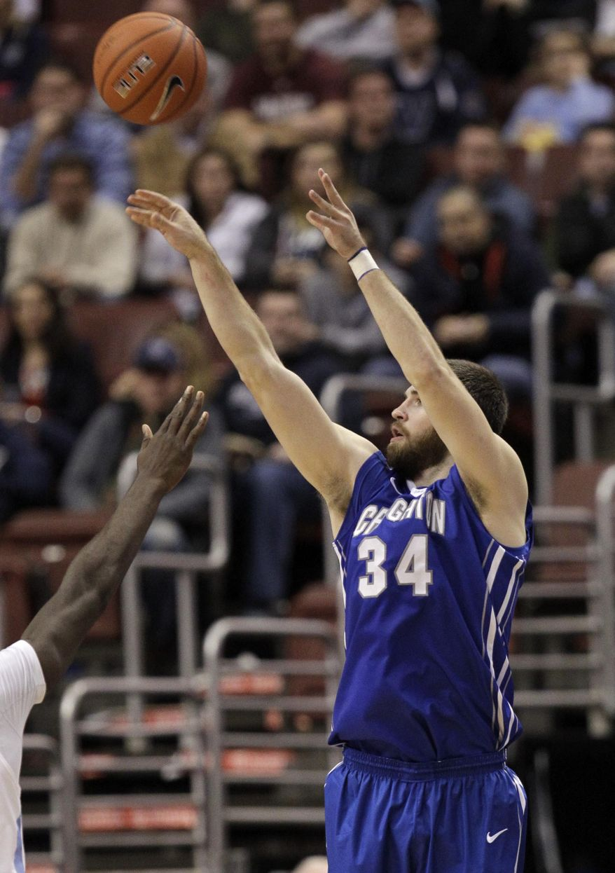 FILE - In this Jan. 20, 2014, file photo, Creighton's Ethan Wragge (34) shoots against Villanova during an NCAA college basketball game in Philadelphia. Wragge showed why he's the best 3-point shooter in the nation by dropping nine of the Bluejays' Big East-record 21 in a 28-point thrashing of No. 4 Villanova. (AP Photo/Laurence Kesterson, File)
