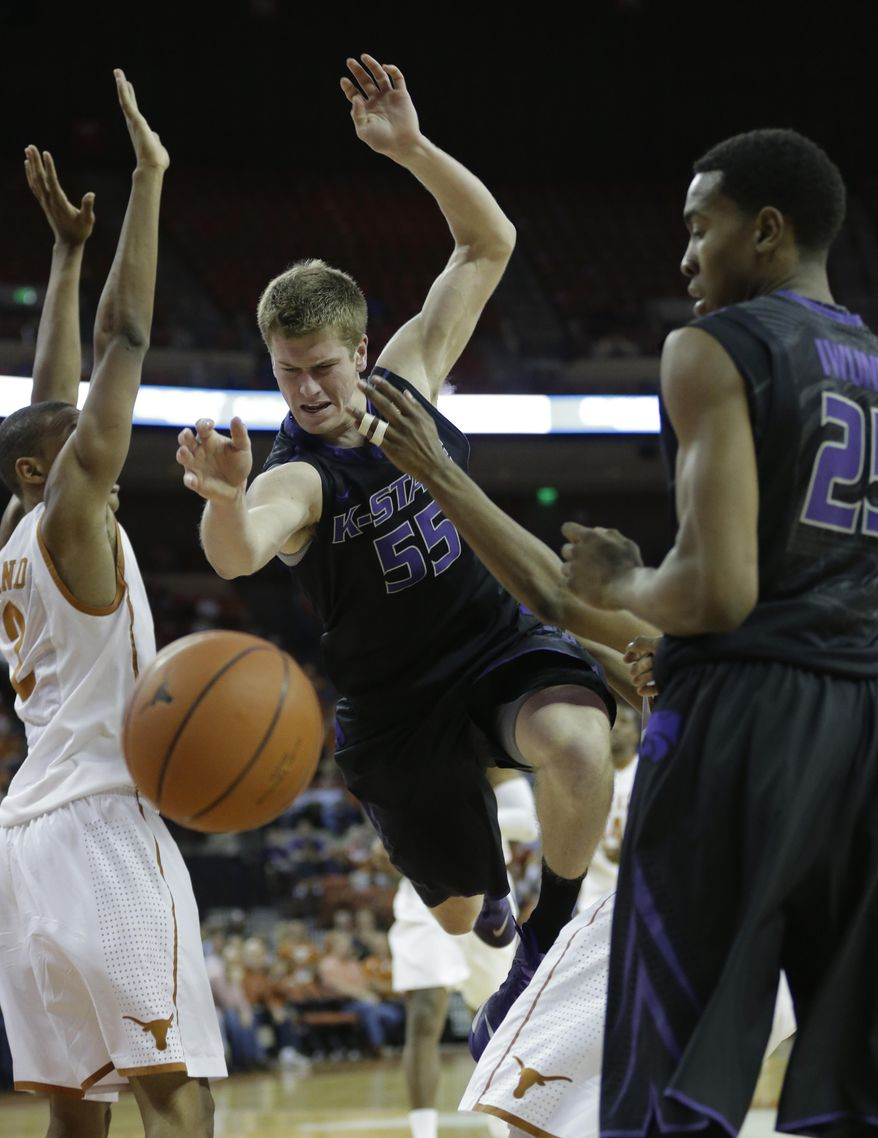 Kansas State's Will Spradling (55) loses control of the ball during the second half of a NCAA college basketball game against Texas, Tuesday,  Jan. 21, 2014, in Austin, Texas. Texas won 67-64. (AP Photo/Eric Gay)