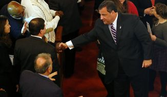 New Jersey Gov. Chris Christie shakes hands as he leaves a prayer service in celebration of his inauguration at the New Hope Baptist Church on Tuesday, Jan. 21, 2014 in Newark.  The celebrations to mark the start of Christie's second term could be tempered by investigations into traffic tie-ups that appear to have been ordered by his staff for political retribution and an allegation that his administration linked Superstorm Sandy aid to approval for a real estate project.  (AP Photo/Rich Schultz)