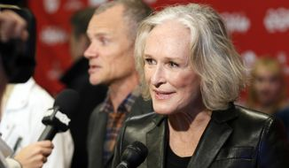 "Cast member Glenn Close speaks with reporters as fellow cast member Flea, rear, of the Red Hot Chili Peppers, is also interviewed at the premiere of the film ""Low Down"" during the 2014 Sundance Film Festival, on Sunday, Jan. 19, 2014, in Park City, Utah. (Photo by Danny Moloshok/Invision/AP)"