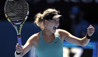 Eugenie Bouchard of Canada celebrates after defeating Ana Ivanovic of Serbia during their quarterfinal at the Australian Open tennis championship in Melbourne, Australia, Tuesday, Jan. 21, 2014. (AP Photo/Rick Rycroft)