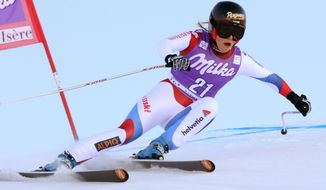Switzerland's Lara Gut competes during an alpine ski, women's World Cup downhill, in Val D'Isere, France, Saturday, Dec. 21, 2013. Marianne Kaufmann-Abderhalden of Switzerland earned her first World Cup victory by winning a women's downhill on Saturday that was marked by a number of big crashes and Lindsey Vonn skiing out and then clutching her injured right knee in pain. (AP Photo/Marco Tacca)