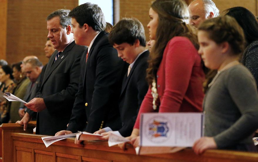 New Jersey Gov. Chris Christie, his wife Mary Pat,  and children Andrew, Patrick, Sarah and Bridget read a prayer as they attend a prayer service in celebration of the governor's inauguration at the New Hope Baptist Church on Tuesday, Jan. 21, 2014 in Newark.  The celebrations to mark the start of Christie's second term could be tempered by investigations into traffic tie-ups that appear to have been ordered by his staff for political retribution and an allegation that his administration linked Superstorm Sandy aid to approval for a real estate project.(AP Photo/Rich Schultz)