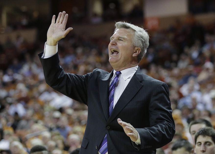 Kansas State coach Bruce Weber talks to his players during the second half of a NCAA college basketball game against Texas, Tuesday,  Jan. 21, 2014, in Austin, Texas. Texas won 67-64. (AP Photo/Eric Gay)