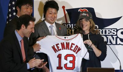 U.S. Ambassador to Japan Caroline Kennedy, right, Red Sox pitchers Junichi Tazawa, second right, Koji Uehara, left, and team's Vice President of marketing Adam Grossman pose for photos as Kennedy receives a Boston Red Sox jersey at the U.S. embassy in Tokyo, Tuesday, Jan. 21, 2014. (AP Photo/Toru Hanai, Pool)