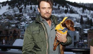 "Actor Josh Duhamel poses with a resuce dog named Charlie while he and Boston Red Sox baseball player David Ortiz, not pictured, helps launch Pedigree Brand's ""See what good food can do."" documentary-style campaign to help shelter dogs during the 2014 Sundance Film Festival, on Monday, Jan. 20, 2014, in Park City, Utah. (Photo by Danny Moloshok/Invision/AP)"