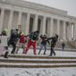 High School students from St. Thomas's church group have a snowball fight in front of the at the Lincoln Memorial during a winter snow storm, in Washington, DC., Tuesday, January 21, 2014. These students are visiting from Tennessee and are a part of the March for Life event being held in the district. (Andrew S Geraci/The Washington Times)