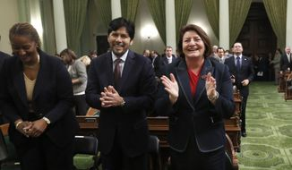 Sen. Kevin de Leon, D-Los Angeles, and Assemblywoman Toni Atkins, D-San Diego applaud Gov. Jerry Brown, before his annual State of the State Address before a joint session of the Legislature at the Capitol, Wednesday, Jan. 22, 2014 in Sacramento, Calif. Assembly Speaker John Perez, D-Los Angeles, announced, that the Democratic caucus has elected Atkins to replace Perez as speaker later this year. De Leon is considered the front-runner to replace Darrell Steinberg, D-Sacramento, as Senate president pro tem who is termed out. (AP Photo/Rich Pedroncelli)