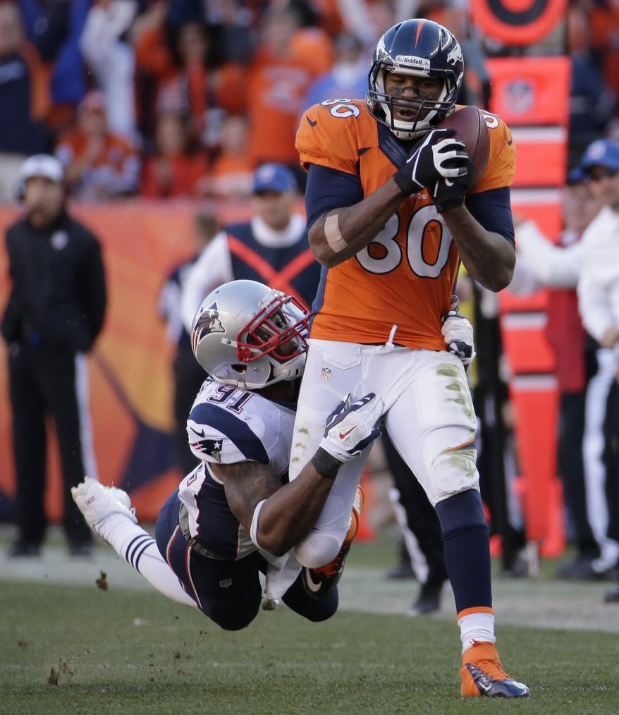 New England Patriots outside linebacker Jamie Collins (91) tries to bring down Denver Broncos tight end Julius Thomas (80) as he heads down field with the ball during the second half of the AFC Championship NFL playoff football game in Denver, Sunday, Jan. 19, 2014. (AP Photo/Charlie Riedel)