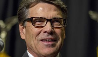 ** FILE ** In this Nov. 7, 2013, file photo, Texas Gov. Rick Perry speaks in Des Moines, Iowa. (AP Photo/Justin Hayworth, File)