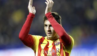 Barcelona's  Lionel Messi from Argentina claps his hands  during their la Copa del Rey soccer match against Levante at the Ciutat de Valencia stadium in Valencia, Spain, Wednesday Jan. 22, 2014. The Argentinean plays his 400th game in an Barcelona shirt in the Copa del Rey against Levante.(AP Photo/Alberto Saiz)