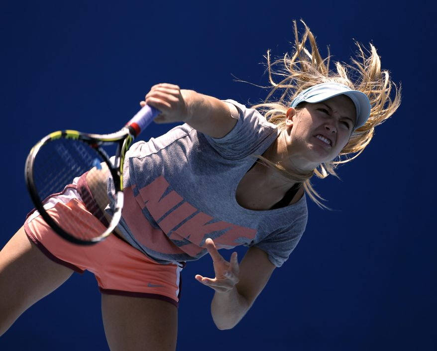 Eugenie Bouchard of Canada practices serving during a training session at the Australian Open tennis championship in Melbourne, Australia, Wednesday, Jan. 22, 2014.  Bouchard will face Li Na of China in the women's singles semifinal Thursday.(AP Photo/Aijaz Rahi)